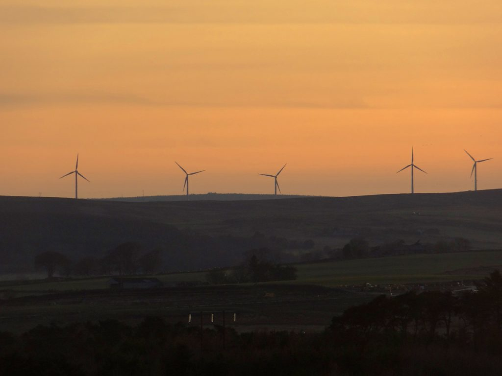 Meikle Carewe wind farm away in the distance