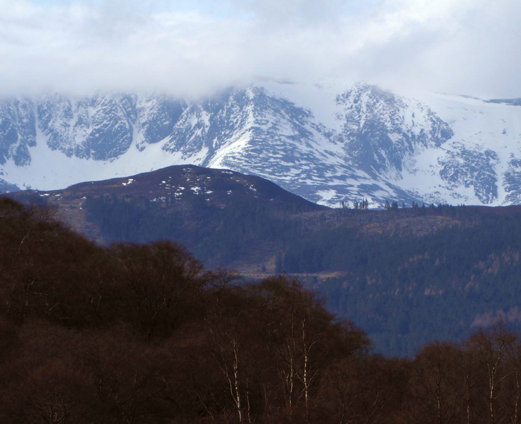 Zooming in to snow capped  munros to the West