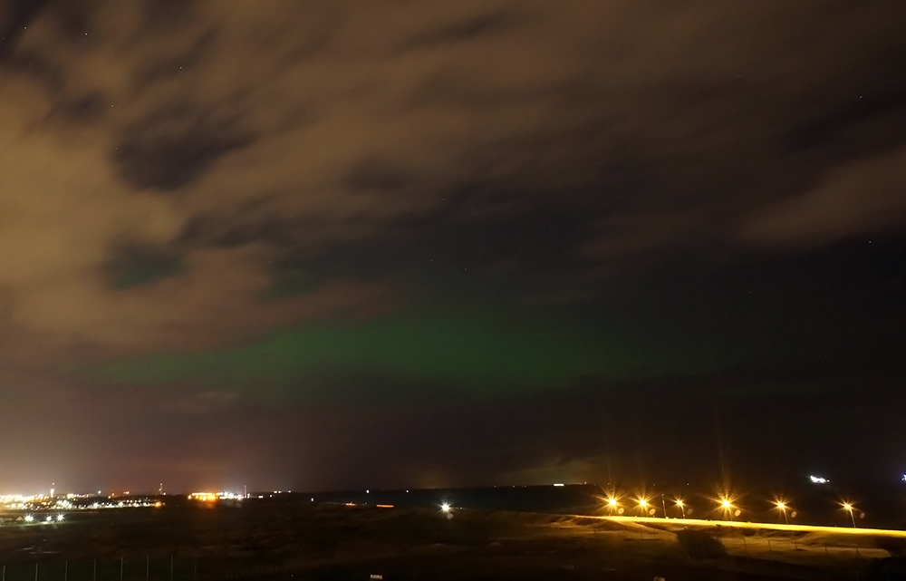 A brief glimpse of Aurora between the clouds