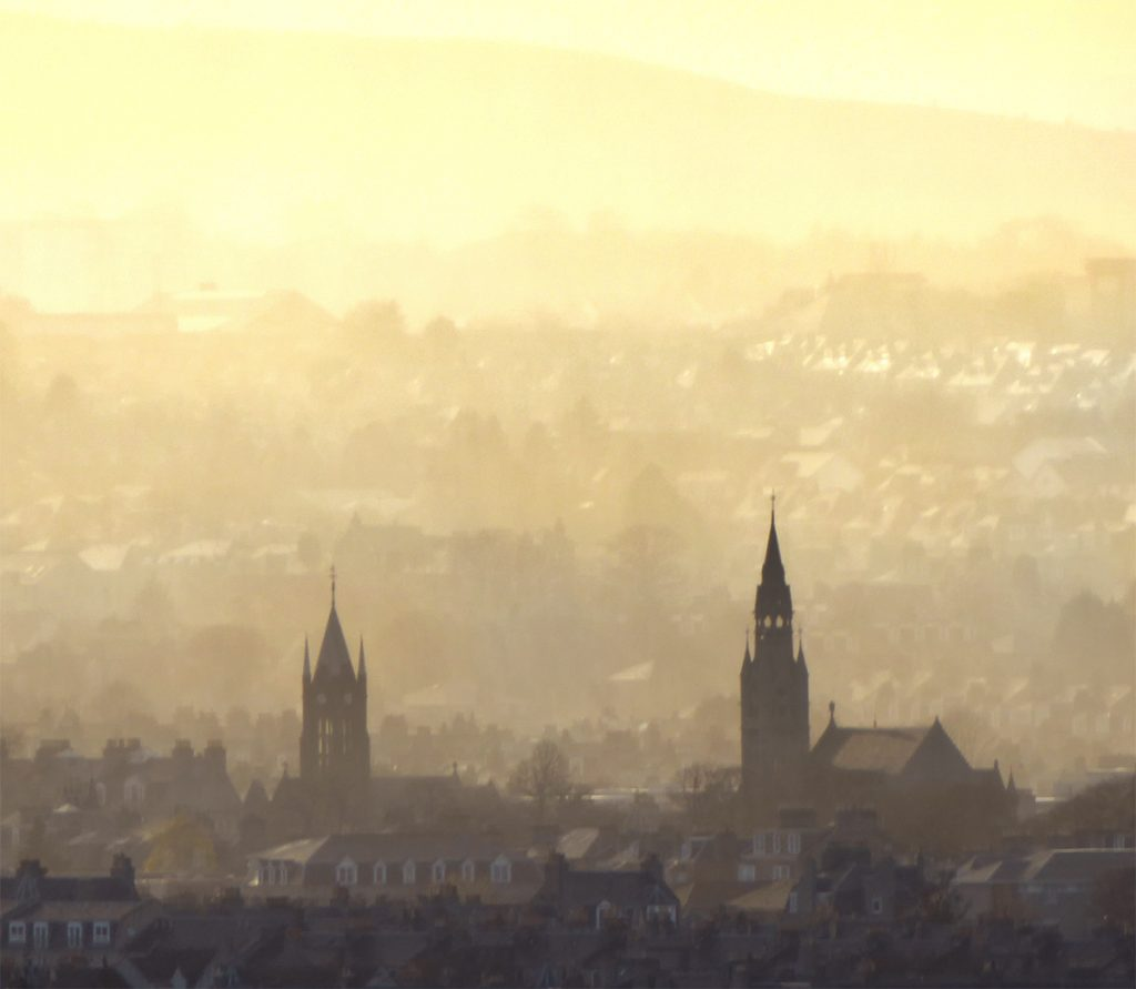 Kirks clear through a hazy sunset looking North West across Aberdeen