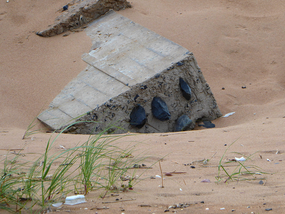 Half buried block