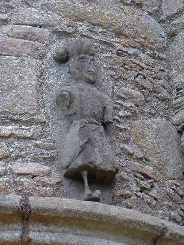 Tolquhon Castle gate gargoyle man